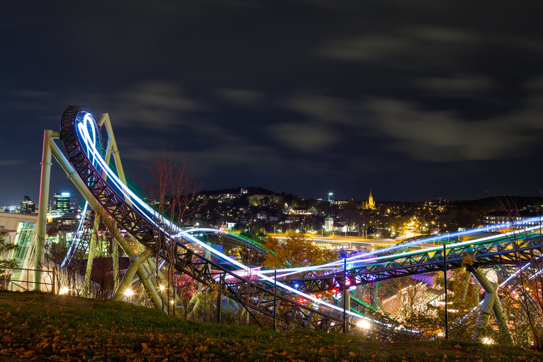 time lapse photography of roller coaster during night time